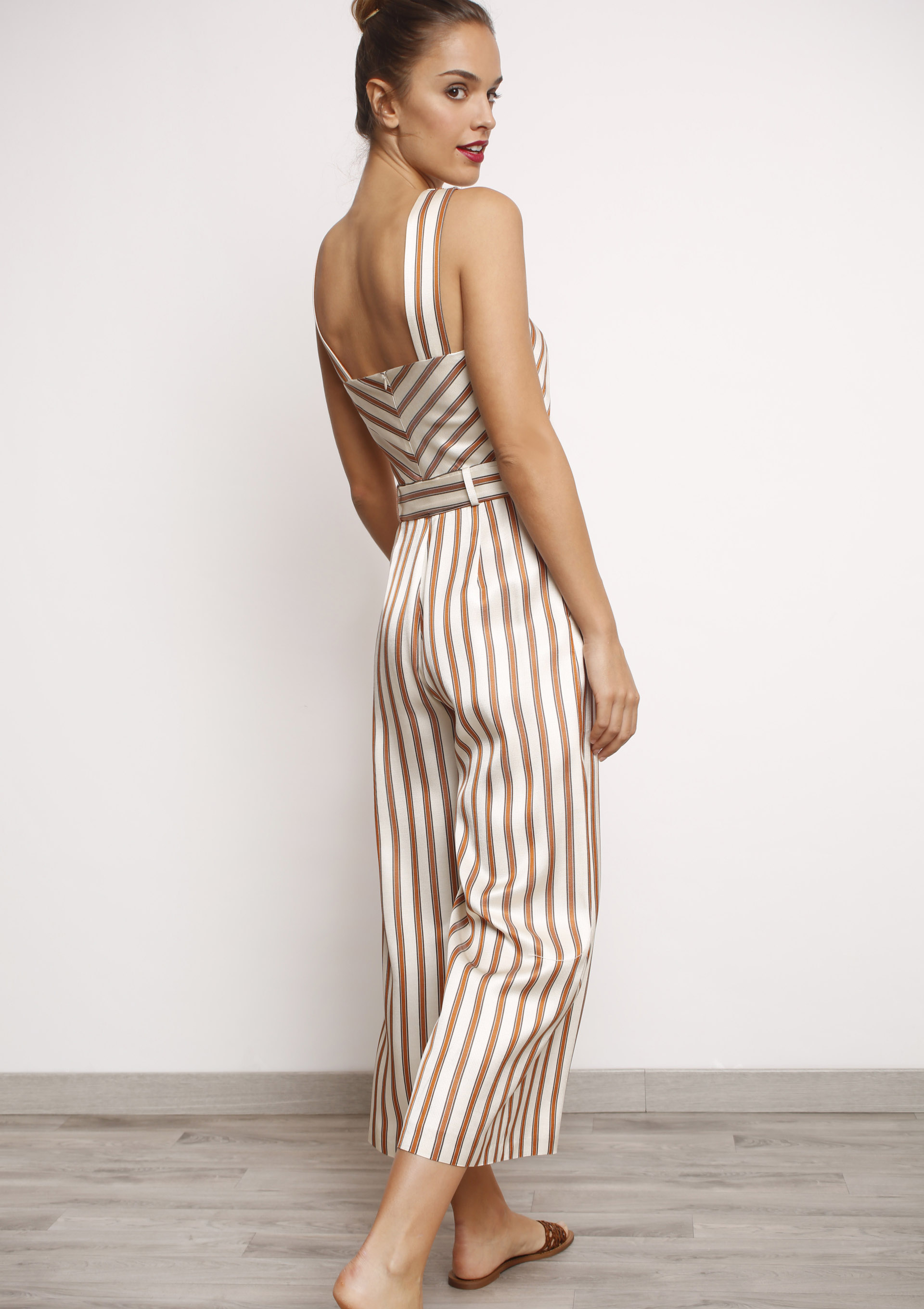 f70b817da710 Striped jumpsuit with wrap front