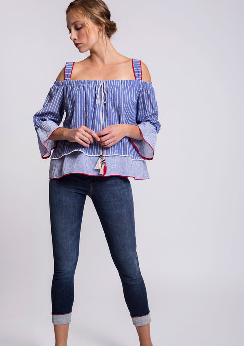 Blue off-the-shoulder blouse with denim trousers