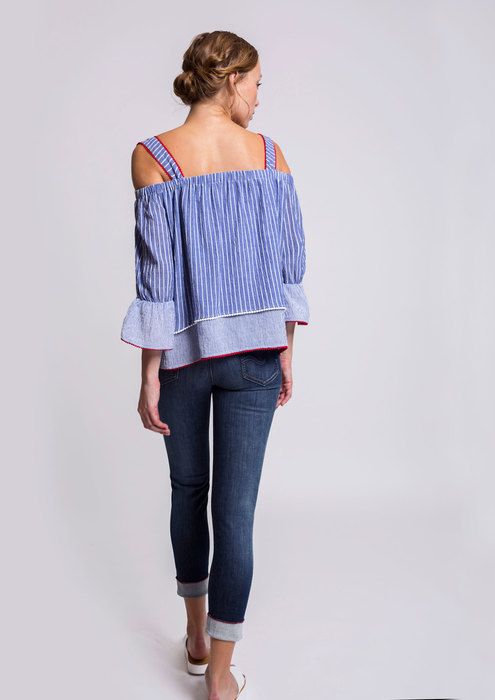 Fluid striped blouse with cigarette denim trousers