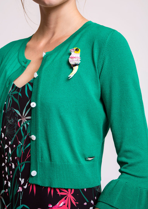 Green knit cardigan with brooch