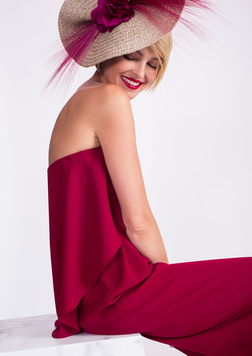 Hat and maroon jumpsuit