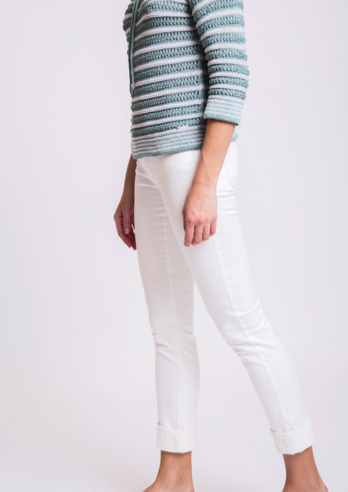 Knit sweater with white trousers