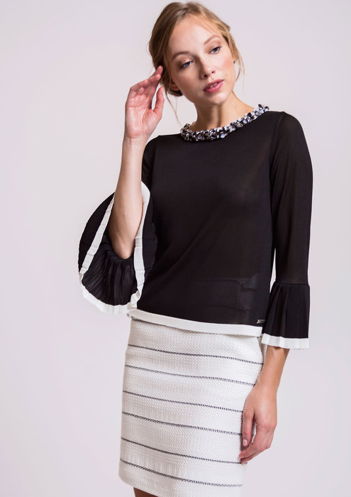 Knit top with embellished neckline