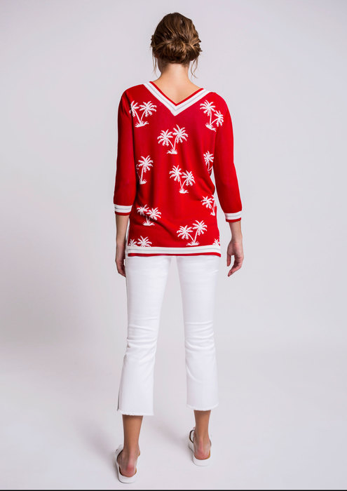 Palm tree sweater with white cigarette trousers