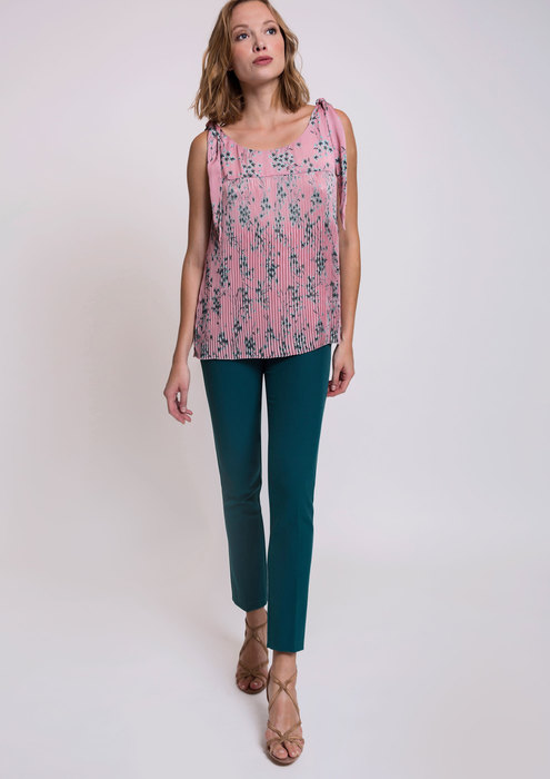 Pink pleated blouse with cobalt trousers