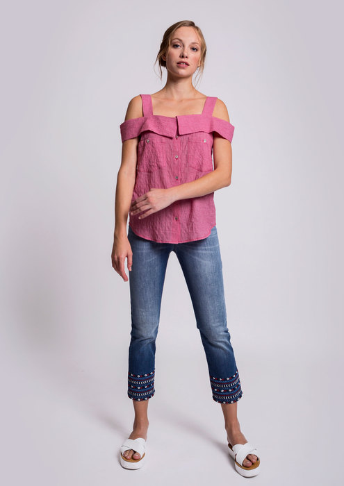 Red blouse with denim trousers