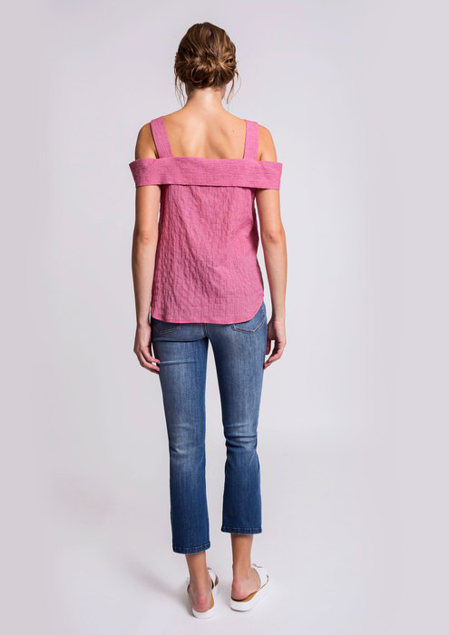 Red blouse with slim fit jeans