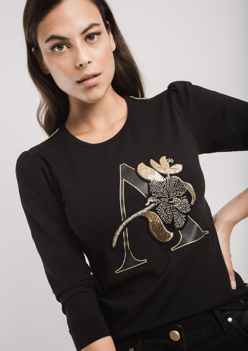 Black T-shirt with gold transfer