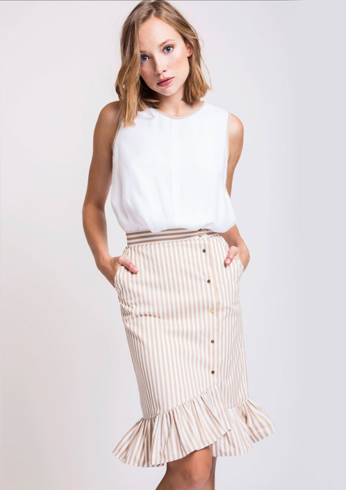 White top with striped skirt